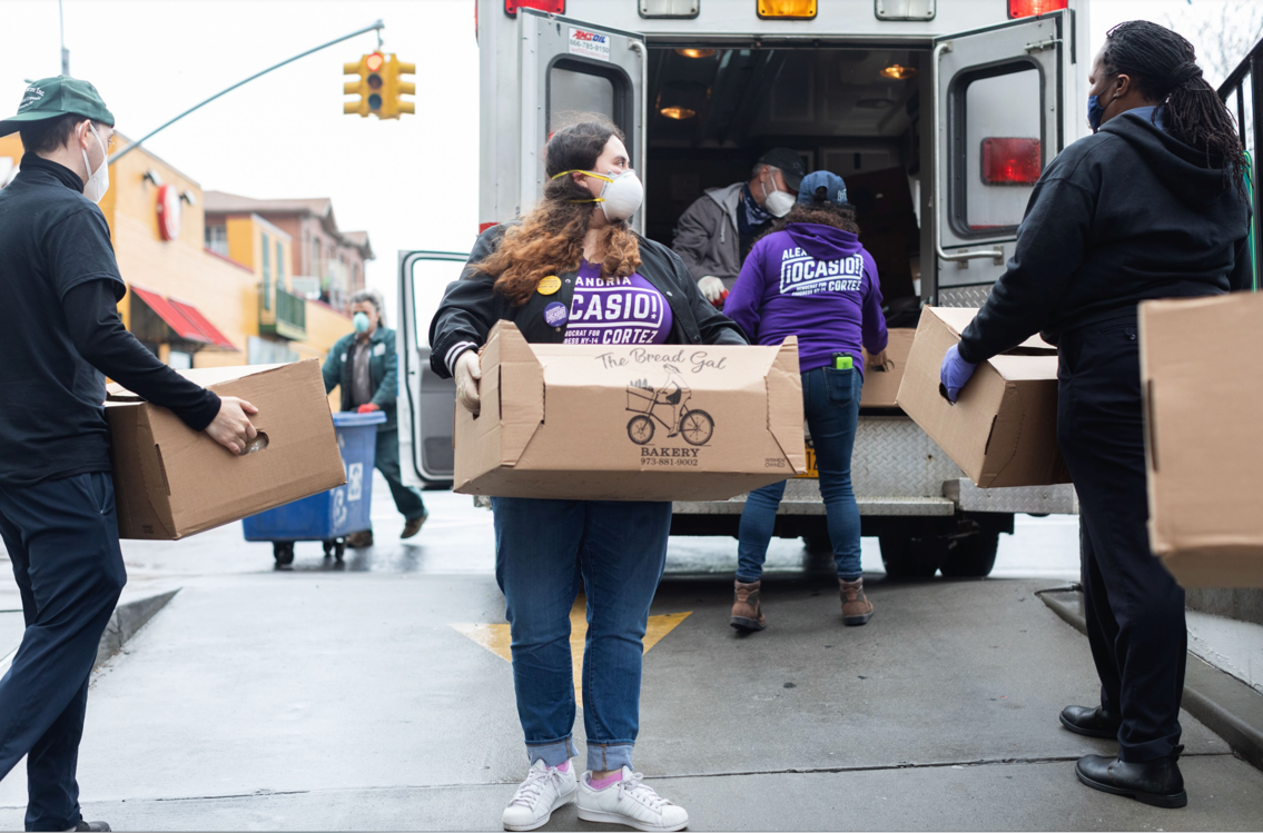 Volunteers loading food supplies into a truck