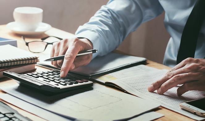 Man using calculator at desk