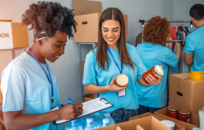 Teens doing community service counting food jars