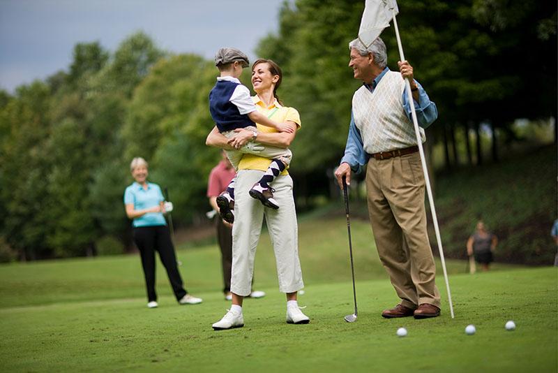 Multi-Generational Family Playing Golf
