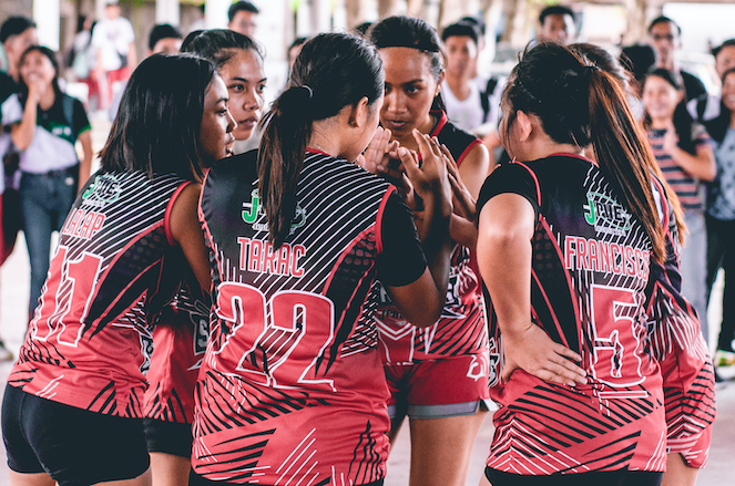 Women's volleyball team huddle
